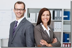 Smiling professional business man and woman